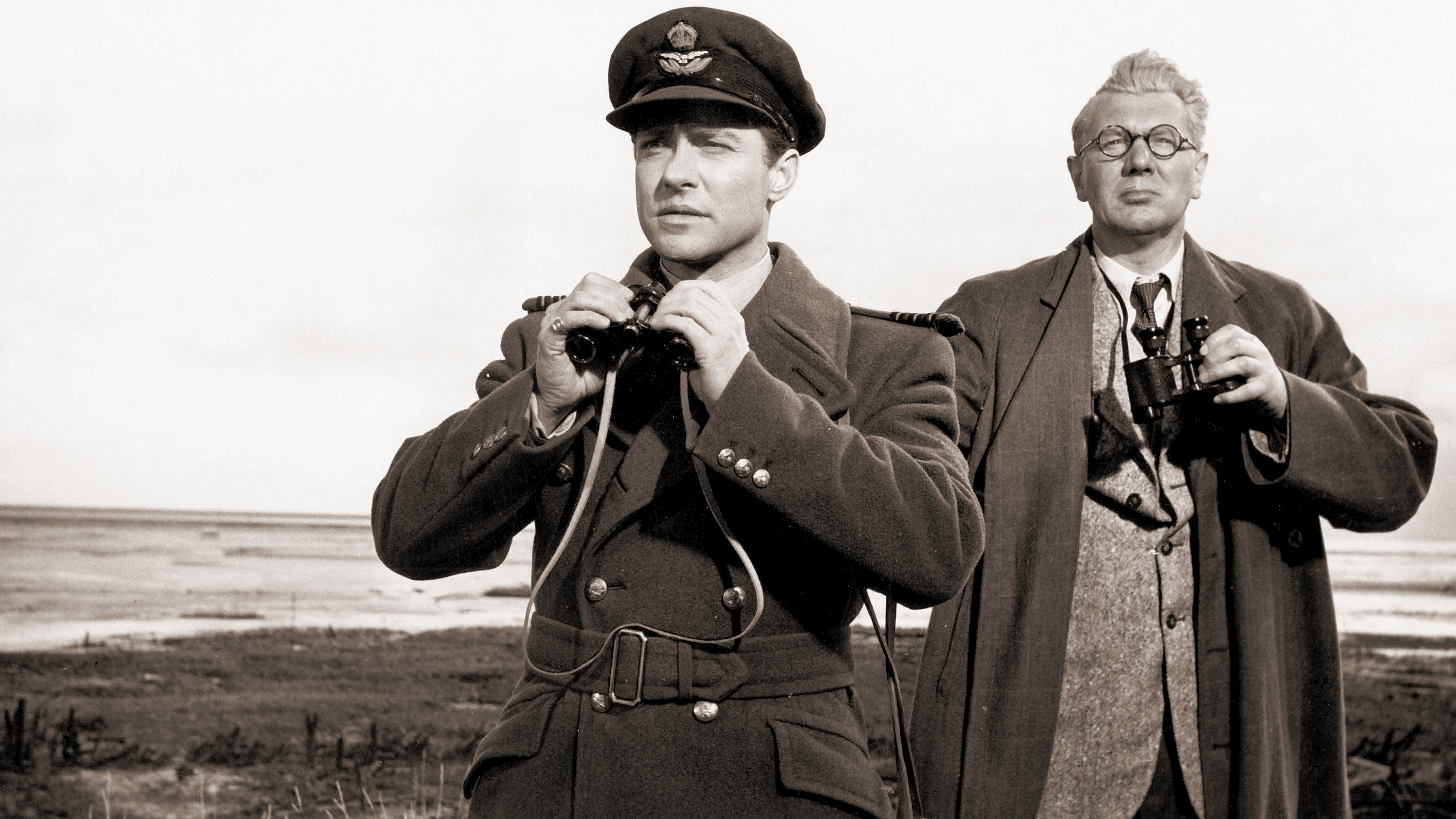 Guy Gibson (Richard Todd) and Barnes Wallis (Michael Redgrave) look out with their field glasses in The Dam Busters (1955)