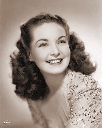 Patricia Roc smiles in a sequinned dress