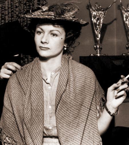 Margaret Lockwood smokes while she wears a shawl
