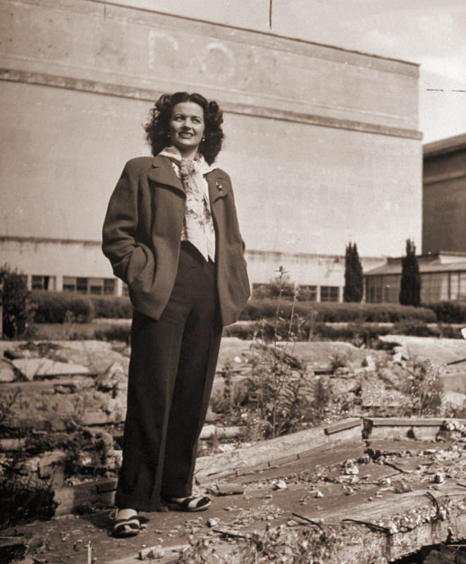 Margaret Lockwood stands in the grounds of a derelict building