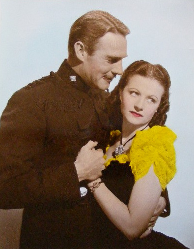 Randolph Scott (as Inspector Angus 'Monty' Montague) and Margaret Lockwood (as Vicky Standing) in a photograph from Susannah of the Mounties (1939) (11)