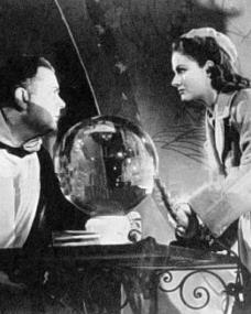 Raymond Lovell (as Professor Winkler) and Margaret Lockwood (as Helene Ardouin) in a photograph from Alibi (1942) (3)