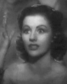 Margaret Lockwood (as Helene Ardouin) in a screenshot from Alibi (1942) (1)
