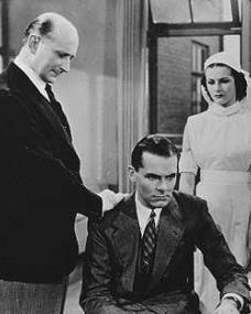 Felix Aylmer (as Surgeon), John Lodge (as Stephen Howard) and Margaret Lockwood (as Catherine Lawrence) in a photograph from Bank Holiday (1938) (4)