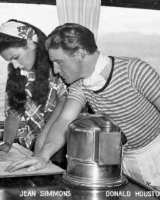 Jean Simmons and Donald Houston aboard the boat Royal Flight