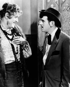 Alastair Sim (as Miss Amelia Fritton) and George Cole (as 'Flash' Harry) in a photograph from Blue Murder at St. Trinian's (1957)