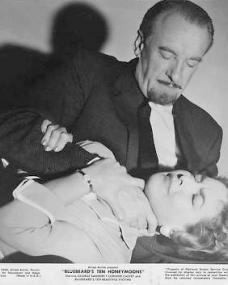 George Sanders (as Landru) and Corinne Calvet (as Odette) in a lobby card from Bluebeard's Ten Honeymoons (1960) (10)