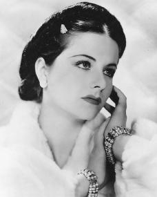 Margaret Lockwood wears bracelets and a white fur