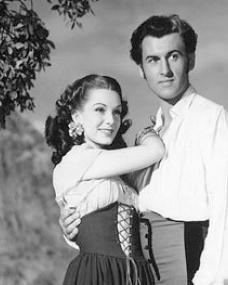 Jean Kent (as Rosal) and Stewart Granger (as Richard Darrell) in a photograph from Caravan (1946) (1)