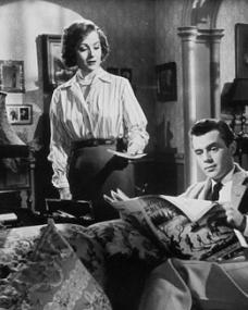 Margaret Lockwood (as Freda Jeffries) and Dirk Bogarde (as Edward Bare) in a photograph from Cast a Dark Shadow (1955) (21)
