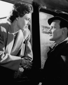 Alec (Trevor Howard) shakes hands with Laura (Celia Johnson) to bid farewell as she leaves on a train in Brief Encounter