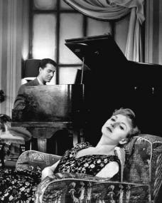 Joan Greenwood (as Lucasta Angel) and Douglas Watson in a photograph from the 'The Confidential Clerk' (1955) episode of BBC Sunday-Night Theatre (1950-59)