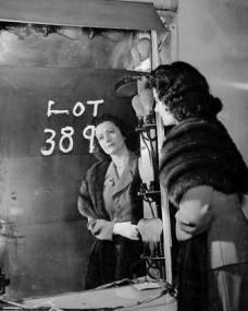 Margaret Lockwood looks in a dilapidated mirror in the old Denham Studios on 3rd March, 1953.