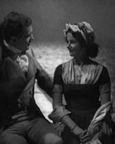 John Loder (as Denis Cobtree) and Margaret Lockwood (as Imogene) in a screenshot from Doctor Syn (1937) (1)