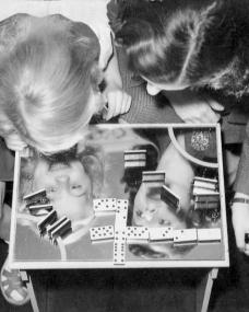 British film star Margaret Lockwood plays dominoes with her daughter Julia Lockwood