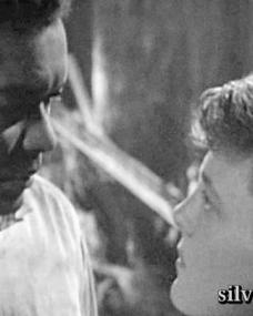 Victor Conway (Earl Cameron) and Danny Willard (David Hemmings) look at each other in The Heart Within