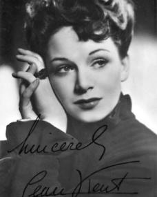 Signed photo of an elegant-looking Jean Kent