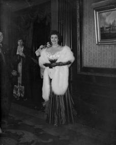 Margaret Lockwood in an evening gown fur stole visits the theatre