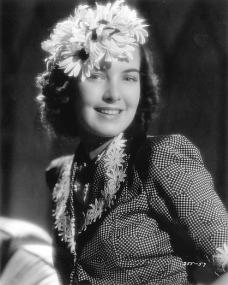 Patricia Roc poses with a flower in her hair