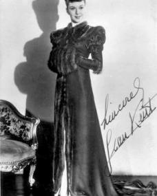Jean Kent wears a fur coat in this autographed picture