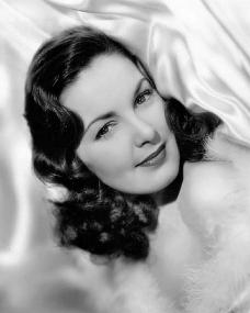 Patricia Roc looks glamorous as she poses in silk sheets for a photograph