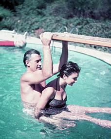 Stewart Granger and Jean Simmons hang off a diving board