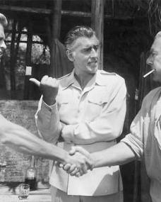 Stewart Granger (as Rian X. Mitchell) in a photograph from Green Fire (1954) (12)