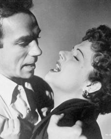 Dane Clark (as Bill Casey) and Margaret Lockwood (as Frances Gray) in a photograph from Highly Dangerous (1950) (13)