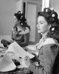 Margaret Lockwood reads the script of Hungry Hill in costume in her dressing room