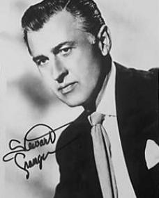 Stewart Granger wears a jacket, tie and handkerchief in an autographed picture