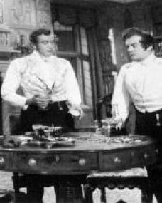 Dermot Walsh (as Barney Hatton), Dennis Price (as Christopher Hatton) and Basil Sydney (as Nick Helmar) in a photograph from Jassy (1947) (8)