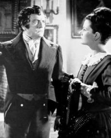 Basil Sydney (as Nick Helmar) and Margaret Lockwood (as Jassy Woodroffe) in a photograph from Jassy (1947) (9)