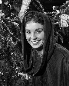 Scenes from Jean Simmons' Christmas Party organised by 'Picturegoer'.  British actress and party host Jean Simmons is pictured next to a Christmas tree.  Pinewood Studios, England, 1949.