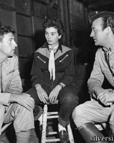 Jean Simmons pays a visit to her fiance Stewart Granger and co-star David Niven on the set of Soldiers Three.  6th November, 1950