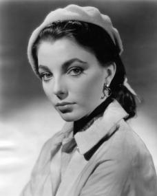 Photograph of Joan Collins from the 1950s. The English actress is sporting a beret