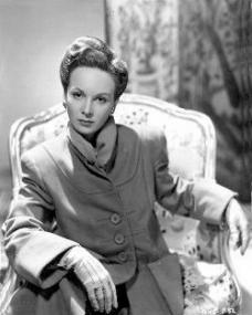 Photo of Joan Greenwood in an overcoat and gloves