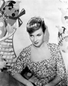Photo of Joan Greenwood in a floral dress