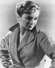 Photo of Joan Greenwood with her hands on her hips