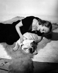 British film star Joan Greenwood  relaxing with her dog.