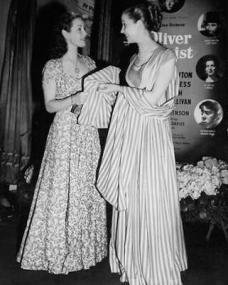 Kay Walsh and Patricia Roc attend the premier of the 1948 British film Oliver Twist
