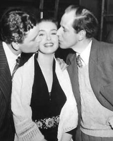 Patricia Roc is kissed on the cheek by her lover Anthony Steel and another man