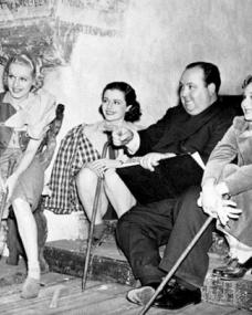 Sally Stewart (as Julie), Margaret Lockwood (as Iris Matilda Henderson), Alfred Hitchcock and Googie Withers (as Blanche) in a photograph from The Lady Vanishes (1938) (27)
