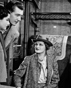 Iris (Margaret Lockwood) and Gilbert (Michael Redgrave) investigate the disappearance of Miss Froy on board a train in The Lady Vanishes