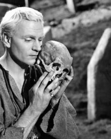 The sight of Yorick's skull in a churchyard evokes a monologue from Prince Hamlet (Laurence Olivier) on mortality