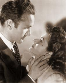 Griffith Jones (as Charles Kent) and Margaret Lockwood (as Ann Markham) in a photograph from Look Before You Love (1948) (14)