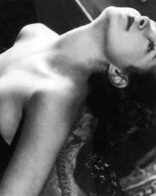 Patricia Roc, star of British cinema, wears a low cut black dress