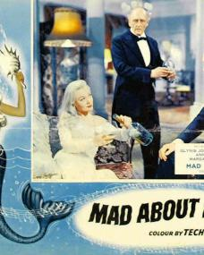 Glynis Johns (as Caroline Trewella / Miranda Trewella) in a lobby card from Mad About Men (1954) (1)