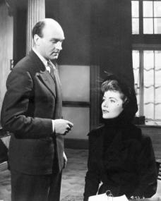 Maurice Denham (as Dr Simon Blake) and Margaret Lockwood (as Lydia Garth) in a photograph from Madness of the Heart (1949) (25)