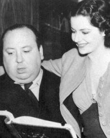 Margaret Lockwood puts her arm around famous British director, Alfred Hitchcock
