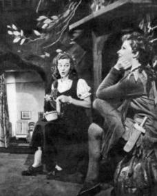 On stage during Peter Pan (1950), Margaret Lockwood (as Peter pan) and Christina Forrest (as Wendy)  enact a scene from the play